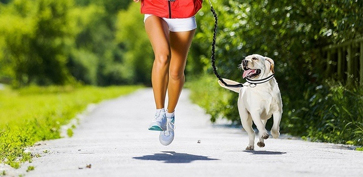 girl running with one of the better dog leashes