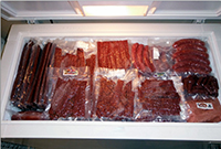 freezer filled with meat for dog