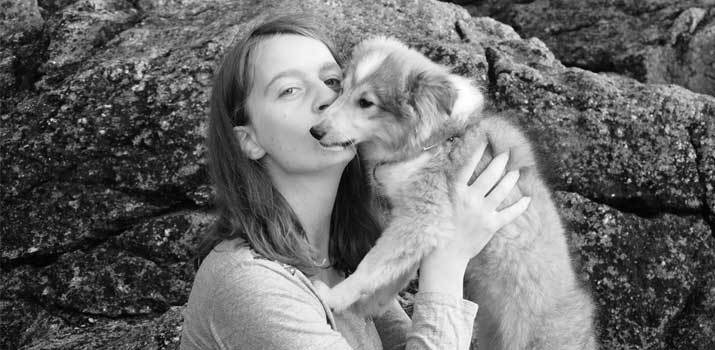 dog being kissed by a human
