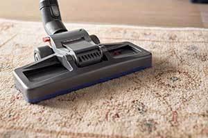 vacuum cleaner to suck the carpet clean